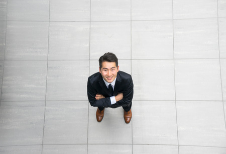 high angle: Asian young & success businessman from top view, high angle Stock Photo