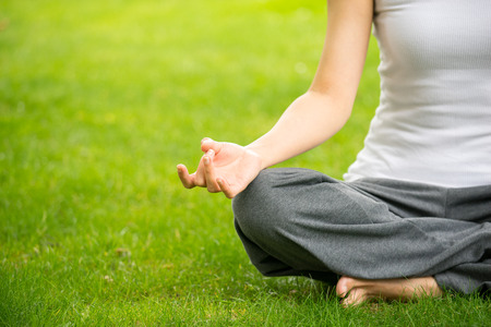 yoga meditation: woman meditating and Yoga in a park