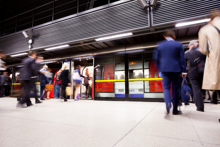 crowded: Travelers movement in tube train station, London