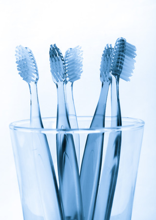 brush in: tooth brush in glass  on white background