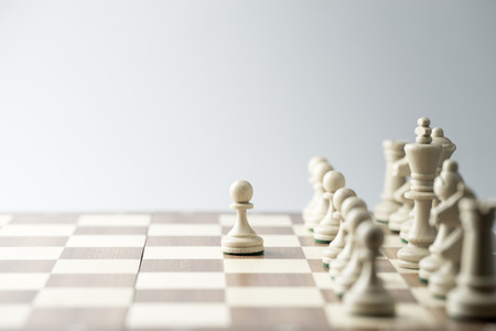 challenges: Chess figure, business concept strategy, leadership, team and success