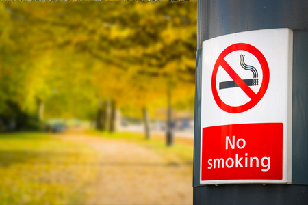statute: no smoking board & sign in the park