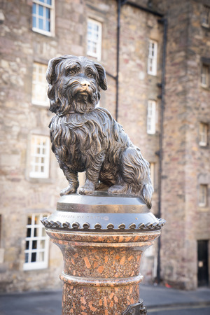 bobby: EDINBURGH - September 10 2014 : Life-size statue of Greyfriars Bobby a Skye Terrier who spent 14 years guarding the grave of his owner, John Gray, until he died on 14 January 1872 on June 07 Editorial