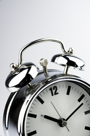 clock work: Metal Alarm clock work time on white background 10 am. Stock Photo