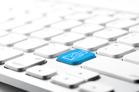 email contact: Email & contact us icon on computer keyboard Stock Photo