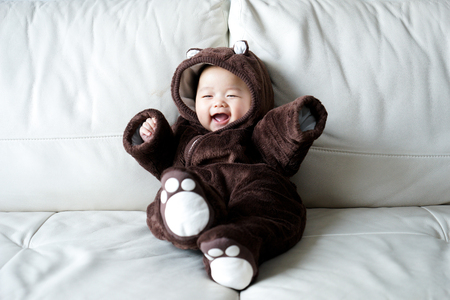 baby in suit: Asian newborn baby wearing bear suit