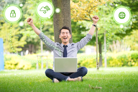 tree service business: Young asian & success businessman using tablet, laptop, mobile phone in the park