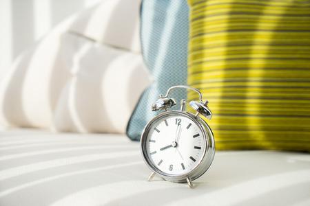 Alarm clock at 8 am. to wake up Stock Photo