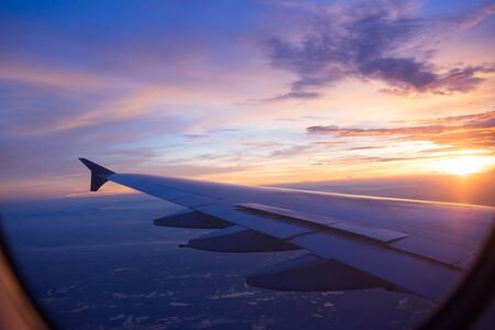 though: Sunset sky from the airplane window Stock Photo