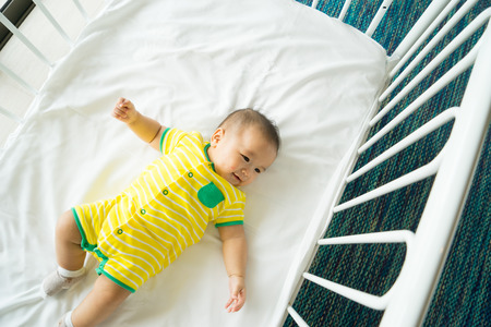 cot: the top view of baby in cot, cradle