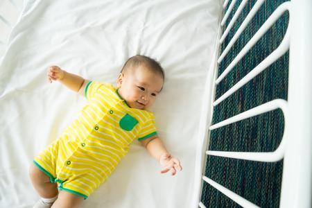 cradle: the top view of baby in cot, cradle