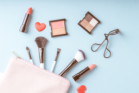 základní: Set of Makeup cosmetics products with bag on top view, vintage style