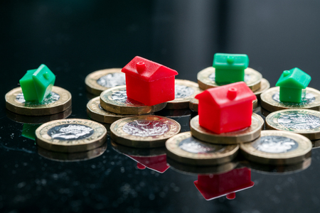 Housing estate concept with coins in studio Stockfoto