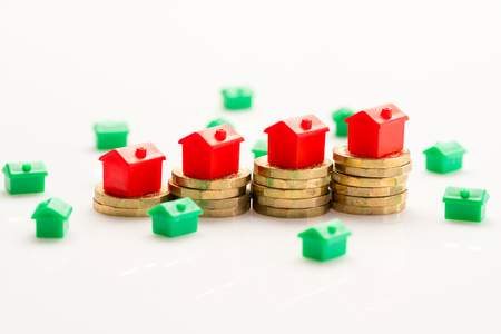 Housing estate concept with coins in studio Stock Photo