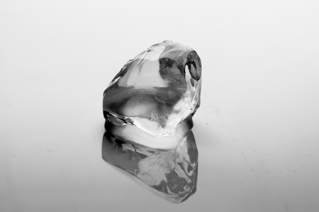 Ice cube melts in studio: Global warming concept