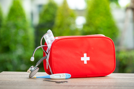 First aid kit bag in outdoor Standard-Bild