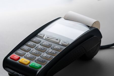 Credit card machine in online payment concept Imagens