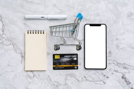 Online payment  concept with shopping cart top view
