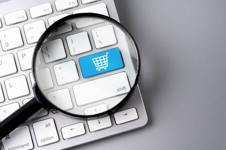 Online shopping & business icon on retro computer keyboard Stock Photo