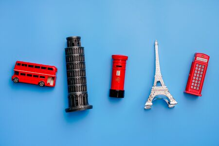 Online booking and travel concept with souvenir