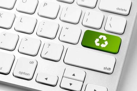 Recycle icon on computer keyboard for green energy concept