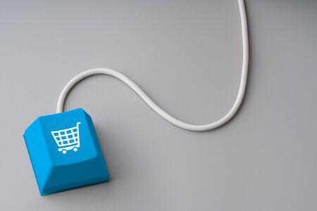 Online shopping & business icon on retro computer keyboard Stockfoto