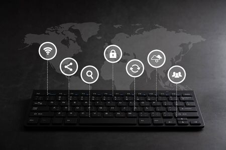 Online shopping & Social media icon on keyboard for global concept