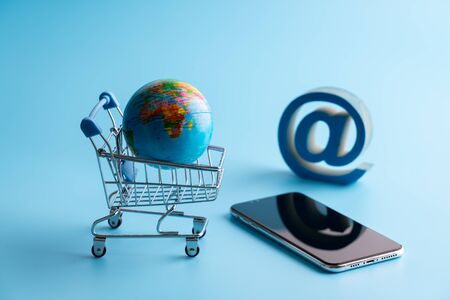 Online shopping icon with globe for global concept