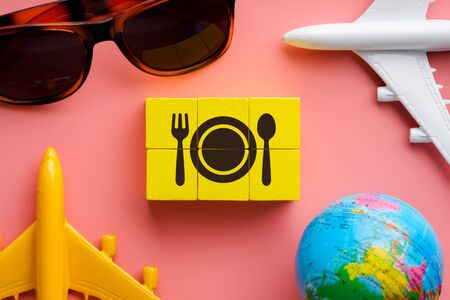 Travel & restaurant icon on colorful puzzle