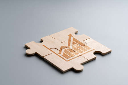 Online shopping icon on wood puzzle