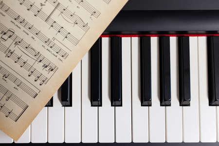 Piano and notes close up