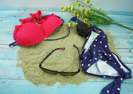 bikini and sun glass in summer concept Stock Photo