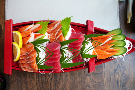 Japanese tradition mixed sashimi on the boat Foto de archivo