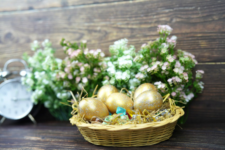 golden eggs for easter and business concept of saving and income