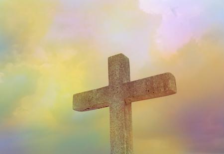 Bright radius and  stone cross on dark sky for background