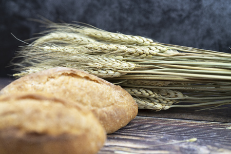 bread and selective focus of wheat on vintage  wood table for background