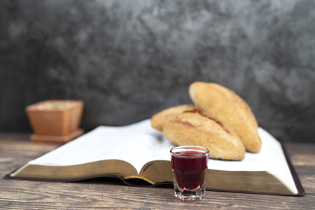 selective focus at  grape juice  with bread and bible for inspiration and background with greeting card Imagens