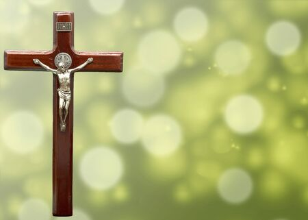 crucifix cross and water drop bokeh for christian inspiration background and presentation