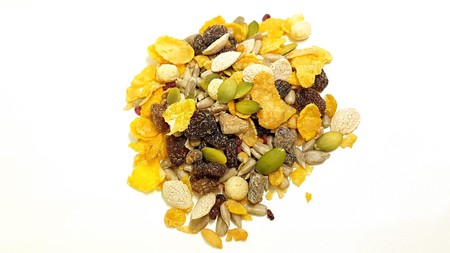 isolated gluten free muesli with dried fruit on white background