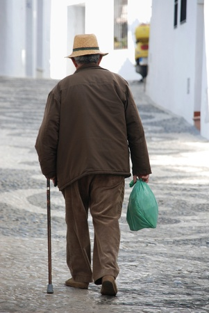 Old man walking photo