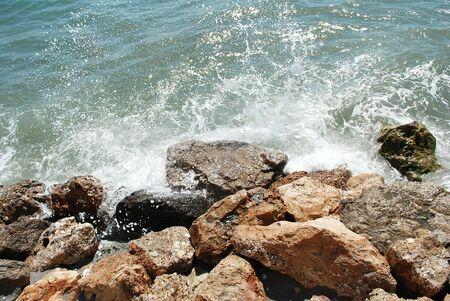 breakwaters: Rocks on the beach