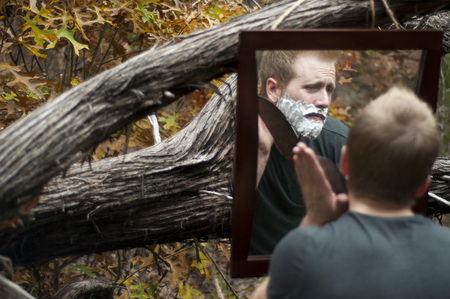 Man Shaving in the Woods With Machete