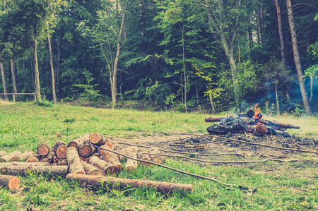 Rustic bonfire near the forest, vintage photo. Stock Photo