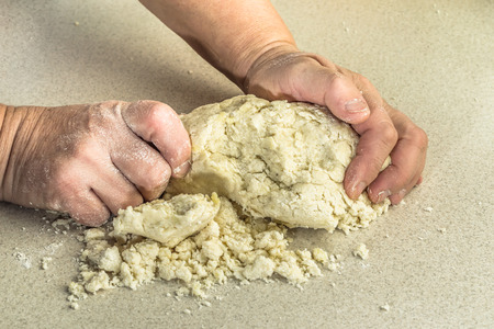 kneading: Kneading of dough with hands.