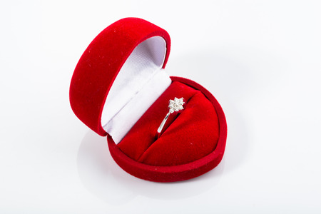 Engagement ring in a box shaped heart. Stock Photo