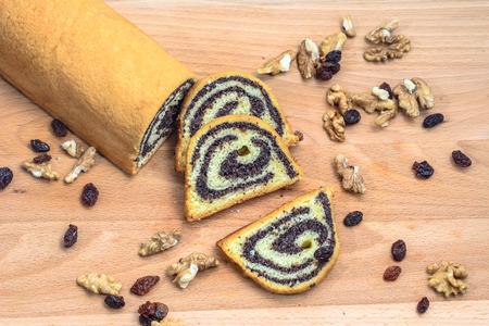 Poppy seed cake on wooden board.