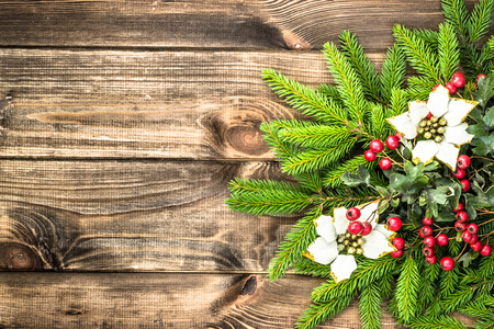Christmas tree with ornaments on wooden background. Stock Photo