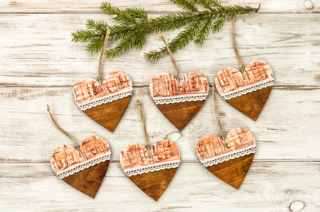 hung: Hanging decoration shaped heart on christmas tree. Stock Photo