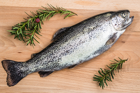 freshwater fish: Raw trout or freshwater fish on a wooden board.
