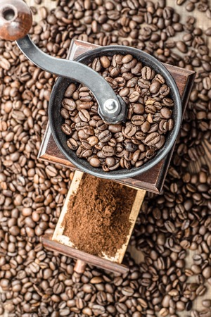 coffee grinder: Coffee grinder and coffee beans background Stock Photo